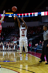 NORMAL, IL - February 07: Tete Maggett shots a 3 pointer while being closely watched by referee LaSha Hopson during a college women's basketball game between the ISU Redbirds and the Braves of Bradley University February 07 2020 at Redbird Arena in Normal, IL. (Photo by Alan Look)