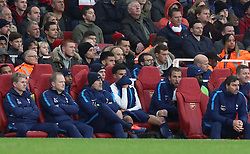Tottenham Hotspur's Dele Alli (centre) and Harry Kane (centre right) on the bench during the Premier League match at the Emirates Stadium, London.