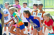 Central Valley, New York - Young runners race on the track in the Coach/Judge Ed Kellmen Ramble Scramble on Aug. 26, 2012.