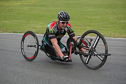 © Licensed to London News Pictures. 19/06/12. Brands Hatch, Kent. Paralympic cyclist from South Africa trains at Brands Hatch, Kent. Up to 150 international athletes come to train at the race circuit at Brands Hatch in Kent for the Paralympic Road Cycling competition taking place on 5-8 September 2012. Picture credit should read Manu Palomeque/LNP