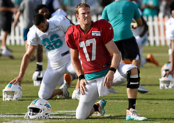 August 3, 2017 - Davie, Florida, U.S. - Miami Dolphins quarterback RYAN TANNEHILL stretches before the start of training camp where he suffered an injury early into Thursday's padded practice in Davie. During the team's first 11-on-11 session Tannehill, Miami's starter for the past five seasons, scrambled to the right and fell at the end of his first down run. He fell into a group of players and apparently buckled his surgically repaired left knee.  (Credit Image: © Sun-Sentinel via ZUMA Wire)