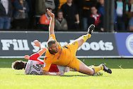 Jon Parkin of Newport county (9) is fouled by Cheltenham's Daniel O'Shaughnessy (24) EFL Skybet football league two match, Newport county v Cheltenham Town at Rodney Parade in Newport, South Wales on Saturday 10th September 2016.<br /> pic by Andrew Orchard, Andrew Orchard sports photography.