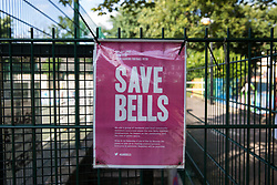 London, UK. 14th August, 2021. A Save Bells notice is displayed on fencing around sports facilities at Bells Gardens in Peckham. Southwark Council proposes to build 97 new homes (a mix of social and private housing), a reprovisioned community facility and a multi-use games area at Bells Gardens, a well-used community park serving the 545-home Bells Gardens estate. Southwark ranks fifth-worst in London and eighth-worst in the UK for easy access to green space.