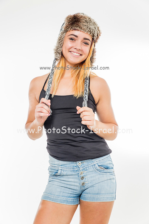 Playful female teen with fur hat wearing black top
