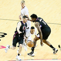 25 April 2016: Los Angeles Clippers guard J.J. Redick (4) and Los Angeles Clippers center DeAndre Jordan (6) defend on Portland Trail Blazers guard Damian Lillard (0) during the Portland Trail Blazers 98-84 victory over the Los Angeles Clippers, during Game Four of the Western Conference Quarterfinals of the NBA Playoffs at the Moda Center, Portland, Oregon, USA.