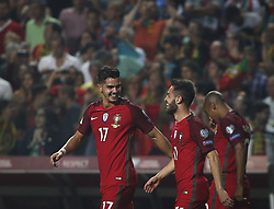 October 10, 2017 - Lisbon, Portugal - Portugal's forward Andre Silva (L) celebrates with Portugal's midfielder Bernardo Silva after scoring a goal during the FIFA 2018 World Cup Qualifier match between Portugal and Switzerland at the Luz Stadium on October 10, 2017 in Lisbon, Portugal. (Credit Image: © Carlos Costa/NurPhoto via ZUMA Press)