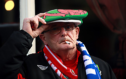 A Wales fan smokes a cigarette outside a pub ahead of the Guinness Six Nations match at the Principality Stadium, Cardiff.