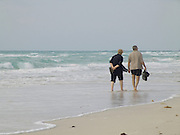 elderly couple walking along the beach Miami Beach USA