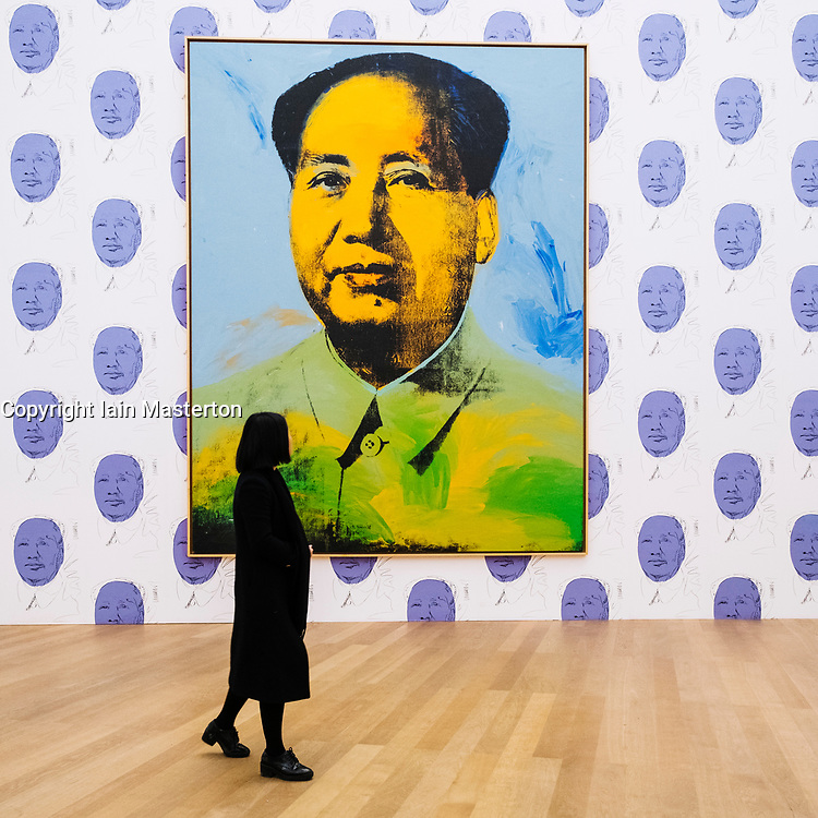 Woman looking at painting Mao by Andy Warhol at Hamburger Bahnhof modern art museum in Berlin, Germany