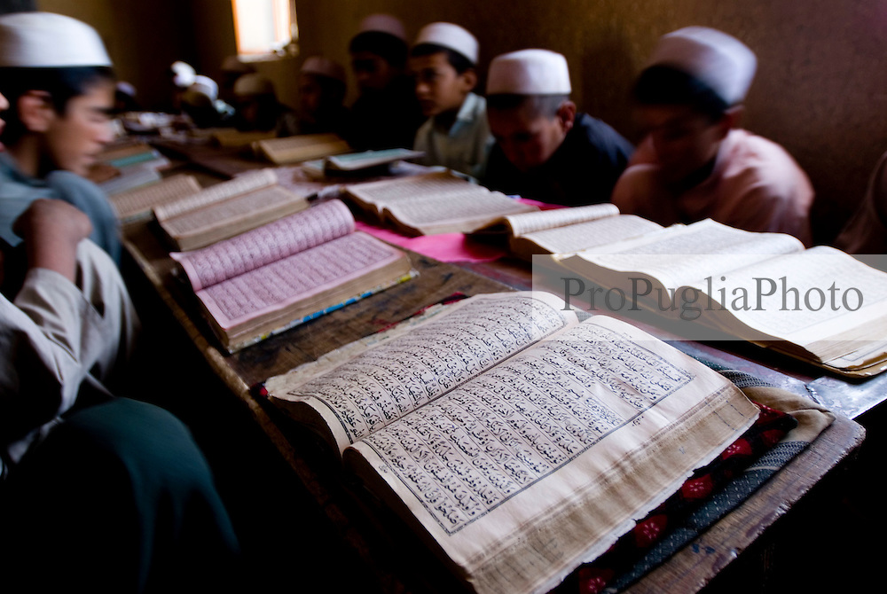 Helmand, 24 September 2006. .Young Muslims aged between 6 and 14 years old learn the Holy Qor'an at a Madrassa in Lashkargah City.