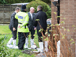 © Licensed to London News Pictures . 11/02/2014 . Blackburn , UK . Police and forensic examiners on Emily Street in Blackburn at the scene where an eleven month old baby girl was mauled to death late last night (10th February 2014) . Photo credit : Joel Goodman/LNP