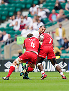 Rugby Canada Prop Djustice Sears-Duru and Rugby lock Regan O'Gorman combine to tackle England prop Ellis Genge during the England -V- Rugby Canada match on Saturday, July 10, 2021, at Twickenham Stadium, Middlesex, United Kingdom. (Steve Flynn/Image of Sport)