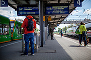 People are waiting for further connections at the railway station in Plattling, Bavaria after the corona virus outbreak changed our public lifes.