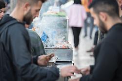 12 April 2019, Jerusalem: A man purchases food near Damascus Gate in Jerusalem.