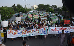 September 11, 2017 - Lahore, Punjab, Pakistan - Members of Awami Rickshaw Union Pakistan chant slogans while protesting against the killing of Rohingya Muslims in Burma in Lahore. More than 1,000 people may already have been killed in the military-led crackdown, which has seen 270,000 mostly Rohingya civilians flee to Bangladesh in the last two weeks alone. (Credit Image: © Rana Sajid Hussain/Pacific Press via ZUMA Wire)