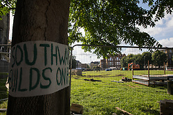 London, UK. 14th August, 2021. A banner objecting to Southwark Council's plans to develop Peckham Green as public housing is displayed around a tree. Peckham Green is a 1.4-acre public park off Peckham High Street, one of the most polluted roads in London, in a borough which is ranked fifth-worst in London and eighth-worst in the UK for easy access to green space, and local residents and campaigners have been protesting that they were not consulted by Southwark Council in relation to its plans.