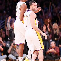 17 November 2013: Los Angeles Lakers point guard Jordan Farmar (1) celebrates with Los Angeles Lakers small forward Nick Young (0) during the Los Angeles Lakers 114-99 victory over the Detroit Pistons at the Staples Center, Los Angeles, California, USA.