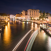 The Grand Canal and the beautiful architecture lining the waterway at night in Venice, Italy.