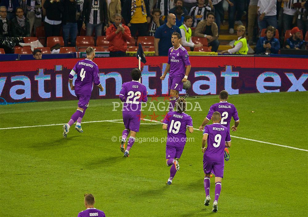 CARDIFF, WALES - Saturday, June 3, 2017: Real Madrid's Cristiano Ronaldo celebrates scoring the first goal against Juventus during the UEFA Champions League Final between Juventus FC and Real Madrid CF at the Stadium of Wales. (Pic by David Rawcliffe/Propaganda)