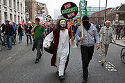 London, UK. Saturday 20th June 2015. Man dressed as Jesus attending the People's Assembly against austerity demonstration through Central London. 250,000 people gathered to protest in a march through the capital protesting against the Tory cuts, holding placards and banners.