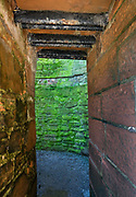 "The formidable red sandstone walls of Caerlaverock Castle have a triangular shape, unique in Britain. First built in 1295 to to control trade, its wide moat, twin-towered gatehouse and lofty battlements give Caerlaverock a fairtale appearance, the epitome of a medieval stronghold. In the castle courtyard, walk through Nithsdale Lodging, a remarkable residence built in 1635, ""the most ambitious early classical domestic architecture in Scotland."" Caerlaverock is near Dumfries, on the edge of Caerlaverock National Nature Reserve, in southwest Scotland, United Kingdom, Europe. This stronghold defended the Maxwell family from the 1200s-1640, then was abandoned. It was besieged by the English during the Wars of Scottish Independence, and underwent several partial demolitions and reconstructions from the 1300s-1400s."