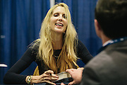 Ann Coulter greets a fan during her book signing during the final day of the Conservative Political Action Conference (CPAC) at the Gaylord National Resort & Convention Center in National Harbor, Md.