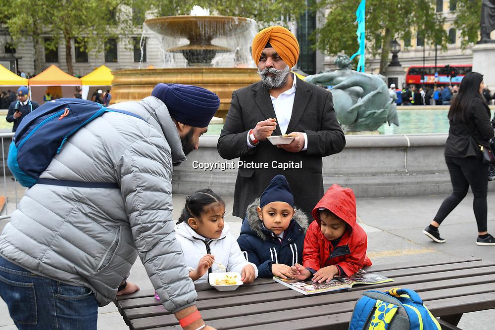 London, England, UK. 27 April 2019. Sikh family attend the  Vaisakhi Festival is a Sikh New Year in Trafalgar Square, London, UK.