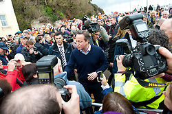 © Licensed to London News Pictures. 04/04/2014. Dawlish, Devon, UK. Crowds greet the Prime Minister at Dawlish railway station. Prime Minister David Cameron opens railway. The Riviera Line railway linking Exeter, Plymouth and Penzance reopens two weeks ahead of schedule and two months after a sea wall was breached and a stretch of the line was badly damaged at Dawlish on February 4th 2014  by large waves and storms  which hit much of the British coastline on 4th February 2014. Photo credit : Graham M. Lawrence/LNP
