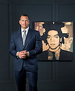"""Alex Rodriguez, nicknamed """"A-Rod"""", is an American former professional baseball shortstop and third baseman who played 22 seasons in Major League Baseball, with a portrait of American artist Jean-Michel Basquiat at his office in Coral Gables on Friday, October 16, 2015."""