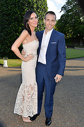 LINZI STOPPARD and WILL STOPPARD at The Ralph Lauren & Vogue Wimbledon Summer Cocktail Party at The Orangery, Kensington Palace, London on 22nd June 2015.  The event is to celebrate ten years of Ralph Lauren as official outfitter to the Championships, Wimbledon.