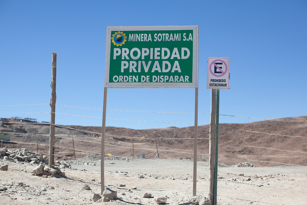 """The sign reads: Minera Sotrami S.A. P""""rivate Property, order to shoot"""""""