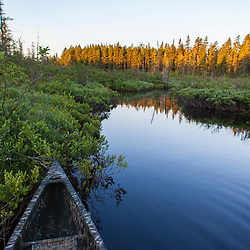 """A canoe on the Cold Stream """"deadwater"""" above Upper Cold Stream Falls in Maine's Northern Forest. Johnson Mountain Township."""