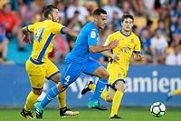 Getafe CF's Bruno Gonzalez (c) and AD Alcorcon's Gonzalo Guijarro (l) and Alvaro Pena during friendly match. August 9,2017. (ALTERPHOTOS/Acero)