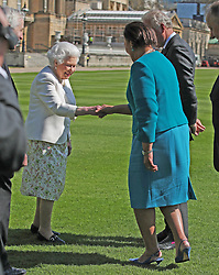 Queen Elizabeth II (left) greets Baroness Scotland, Secretary General of the Commonwealth during the unveiling of a panel marking the walkway in Buckingham Palace gardens, London, in relation to the Commonwealth Walkway project.