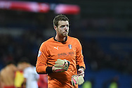 Adam Collin, the Rotherham Utd goalkeeper takes his gloves off at the end of match.  Skybet football league championship match, Cardiff city v Rotherham Utd at the Cardiff city stadium in Cardiff, South Wales on Saturday 6th December 2014<br /> pic by Andrew Orchard, Andrew Orchard sports photography.