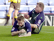 Reading, Berkshire, UK., 26th October 2003, Zurich Premiership Rugby, Madejski Stadium, England, [Mandatory Credit: Peter Spurrier/Intersport Images],<br />  <br /> <br /> 2003_04 Zurich Premiership Rugby - London Irish v Rotherham<br /> Jon Benson, touch's down for Rother first first half try. Exiles Neal Hatley slide in.