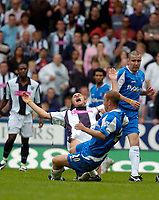 Photo: Leigh Quinnell.<br /> West Brom v Birmingham City. The Barclays Premiership. West Broms Ronnie Wallwork screems with pain as he is challenged by Birminghams Nicky Butt.<br /> 27/08/2005.
