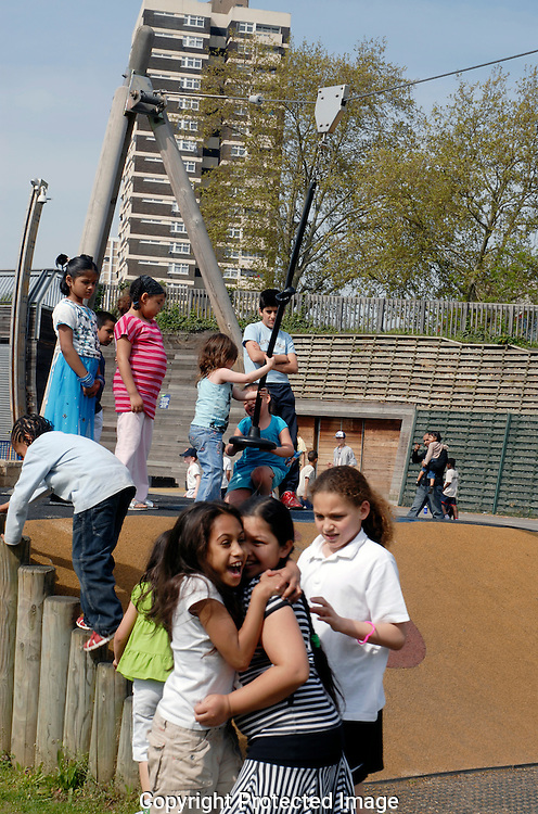 Children playing in adventure playground east end London