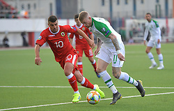 Gibraltar's Liam Walker (left) and Republic of Ireland's James McClean (right) battle for the ballduring the UEFA Euro 2020 Qualifying, Group D match at the Victoria Stadium, Gibraltar.