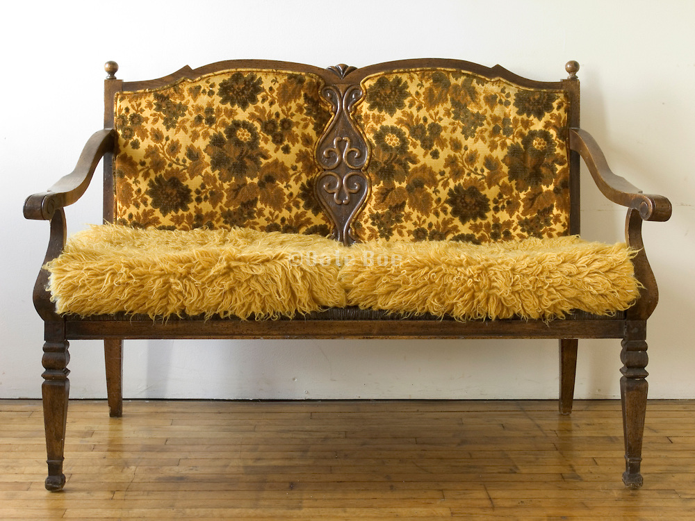 a straightforward view of on old style two sitter bench