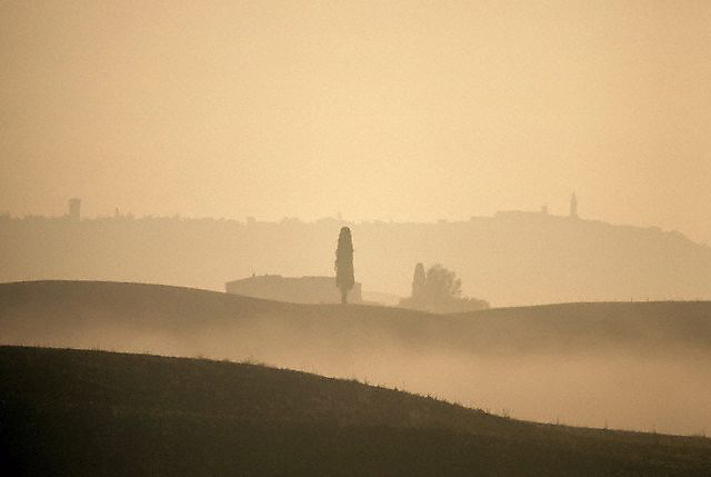 August 1997, Tuscany, Italy --- Fog Shrouding Tuscan Hills --- Image by © Owen Franken/CORBIS
