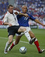 Lisboa 13/6/2004 European Championships<br />Wayne Rooney and Mikael Silvestre<br />Photo Graffiti