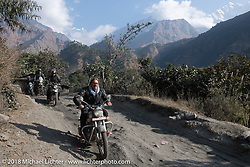 Beanre (Kevin Doebler) with the Annapurna Range in the background on Day-7 of our Himalayan Heroes adventure riding from Tatopani to Pokhara, Nepal. Monday, November 12, 2018. Photography ©2018 Michael Lichter.