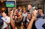 Hopeful World Cup fans display a range of emotion Tuesday at Q Roadhouse and Brewing Co. as the U.S. World Cup team takes a shot and misses during their game against Belgium. The U.S. team lost the game 2-1.