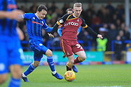 Ollie Rathbone battles Luke O'Brien for the ball during the EFL Sky Bet League 1 match between Rochdale and Bradford City at Spotland, Rochdale, England on 29 December 2018.