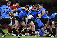 Juan Gaminara of Uruguay passes the ball to his teammate Alejo Duran (22). Rugby World Cup 2015 pool A match, Wales v Uruguay at the Millennium Stadium in Cardiff, South Wales  on Sunday 20th September 2015.<br /> pic by  Andrew Orchard, Andrew Orchard sports photography.