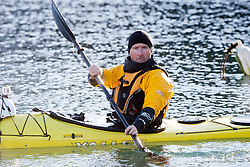 Glen Charles. Scottish Sun sports editor Iain King takes part in a practise session for his charity kayak challenge, in the waters of the harbour at St Abbs..Pic © Michael Schofield...