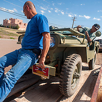 082813       Brian Leddy<br /> Regan Hawthorne helps his father Roy, a Navajo Code Talker, unload a 1946 Jeep Thursday in Gallup. Hawthorne was talking the vehicle to a mechanic in hopes of getting it running for next week's Navajo Nation Fair parade.
