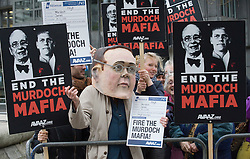 © Licensed to London News Pictures. 29/11/2011. London, UK. An anti Murdoch demonstration outside the Queen Elizabeth II conference centre in London today (29/11/2011) where the BSkyB annual general meeting is being held.  Photo credit : Ben Cawthra/LNP