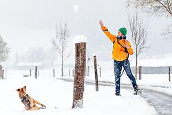 28.04.2017, Piesendorf, AUT, Wintereinbruch in Salzburg, im Bild eine Frau spielt mit ihrem Schäferhund im Schnee // A woman playing with her shepherd in the snow in Piesendorf, Austria on 2017/04/28. EXPA Pictures © 2017, PhotoCredit: EXPA/ JFK